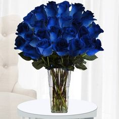 Two dozen dark blue roses! Bright Blue Color Roses Send a Strong, Unwavering Message of Love  Tradition holds that blue roses signify the impossible, the attainable. Receiving two dozen of these glorious flowers suggests that anything is possible for the one who receives them. That's why sending this stunning bouquet is one of the strongest messages of love you can send. $89.97