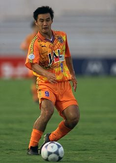 Japanese side Shimizu S-Pulse have a habit of wearing eye-popping kits – this effort, from is among of collection of bright orange designs featuring world maps across the chest. Note also the subtle camouflage pattern in the background Soccer Kits, Football Kits, Football Jerseys, J League, Orange Design, Vintage Football, Team Shirts, The Guardian, Vintage Clothing