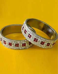 #Bangles, #Bracelets & #Kadas - Red & Silver Stone Studded Bangles Costs Rs. 770. #Jewellery. BUY it here: http://www.artisangilt.com/jewellery/bangles-bracelets-kadas/red-silver-stone-studded-bangles.html?ref=pin