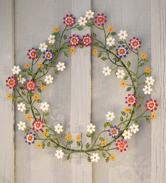 Display our Painted Metal Wreath with Daisies indoors or out for an instant refresh! This wreath's an easy way to add colorful nature to your home as the painted metal flowers create a cheerful presentation. Indoor Wreath, Outdoor Wreaths, Recycled Metal Art, Unique Wall Art, Metal Flowers, Wire Art, Metallic Paint, Holiday Wreaths, Porch Decorating