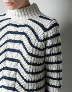 My friend Angie just pointed this out to me. I adore the collar, the stripe and the pattern on this chunky knit.