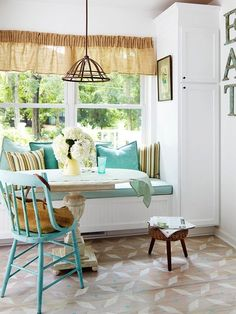 Dining Rooms With Turquoise Wooden Diniing Table And Chair And Colorful Pillows And Brown Carpet