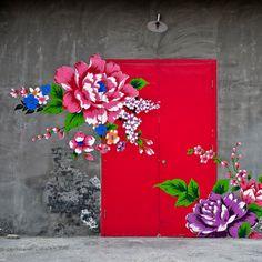 Floral wall mural over red shop door in Beijing (Flickr - Terry.L)