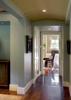 Beautiful, tall baseboards and bright paint color in hallway