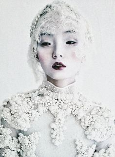Xiao Wen Ju wears Givenchy Haute Couture F/W 2011 in 'Magical Thinking' shot by Tim Walker for W March 2012.