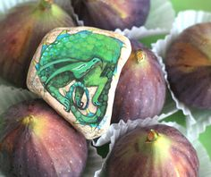 Stone with a hand-painted sleeping dragon talisman by SkadiaArt