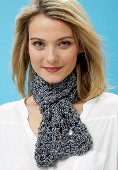 Prepare to be dazzled by this scarf, crocheted in a lacy pattern with afterthought edging! Shown in Patons Metallic #crochet