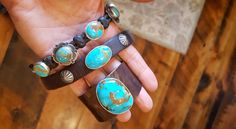 ~ Brit West's fab stackable leather and turquoise cuffs: Perfect Oval, Mas Gtrande & her Concho Braided Bracelet, top @ $348.00). ~