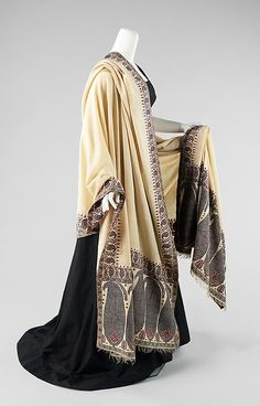 Shawl; 19th century; The Metropolitan Museum of Art. In the mid-late 19th century, when machine woven European copies of imported Kashmir shawls dominated the fashion scene, costly handmade originals were still imported for wealthy customers. When styles changed from the wide hoop skirts and voluminous shawls of the 1860s to the bustle dress and shaped mantle of the 1870s, these beloved shawls were incorporated into the new fashion. https://www.vintagetextile.com/new_page_325.htm