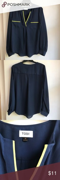 Tobi Navy blouse, size M... EUC! Gorgeous navy blouse with neon lime trim. Pockets at front, buttons at cuffs. %100 polyester. Extra button included. EUC- worn once and shows no signs of wear. Size Medium (could also fit as a flowy small) Tobi Tops Blouses