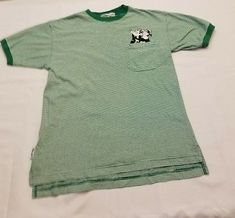 Acme Clothing Small mens Looney Tunes Pepe Le Pew green striped pocket tee shirt