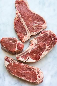 Let's talk steak — a big, beautiful slab of beef. I used to only eat steak when my parents treated us to an old-school steakhouse, and while I relished every minute of those meals, the menu always intimidated me. What was the difference between a New York steak and a ribeye? Why was filet mignon so freakin' expensive?       Whether you cook steak at home or save it for a special occasion out like we did, it's important to know your high-end steak cuts. Here are the four most popular ones, ...