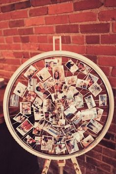 Couples pictures on display at a wedding reception pinned to a bicycle wheel Saying I do...with your bike! | GiveLoveCycle