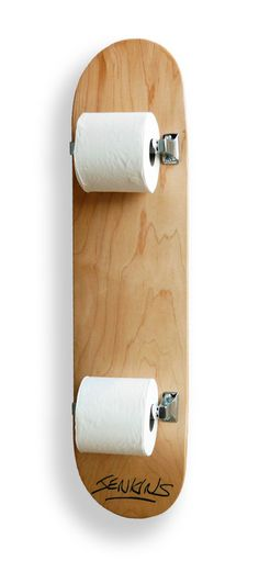 Mark Jenkins | Wipe-out Skateboard deck with stainless steel toilet roll holders and toilet rolls Signed and numbered edition of 3 86.5 cm x 20.5 cm x 23 cm £1140