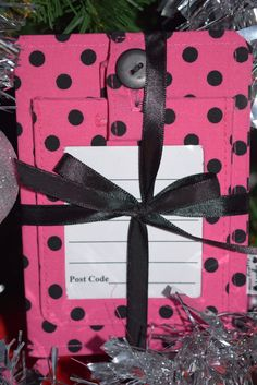 Matching cerise pink polka dot passport wallet and suitcase label travel accessory set