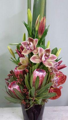Cymbidium orchids, protea and anthirium Orchid Flower Arrangements, Tropical Floral Arrangements, Altar Flowers, Flower Centerpieces, Flower Vases, Flower Decorations, Hotel Flowers, Corporate Flowers, Cymbidium Orchids