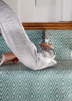 Learn how to install a rug runner on your staircase for under $120... it's easy!
