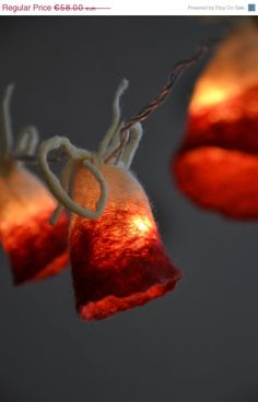 Garland of 10 felted flower buds in natural wool. For decoration and lighting of rooms, the living room, the hallway or any other room in the