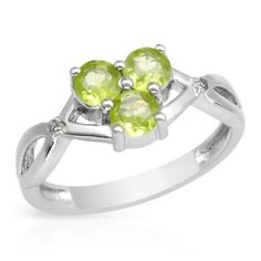 Ring With Diamonds  And Peridots Size 7   Size 7. Wonderful ring with genuine diamonds and peridots well made in 925 sterling silver. Total item weight 2.6g. Gemstone Info: 2 diamonds, 0.01ctw., round shape and accent color. Clarity: ACCENT. 3 peridots, 0.90ctw., round shape and golden green color.