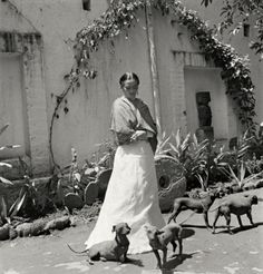 Frida Kahlo with her dogs in Coyoacán, Mexico City, 1951.  The artist was a huge fan of  xoloitzcuintles.