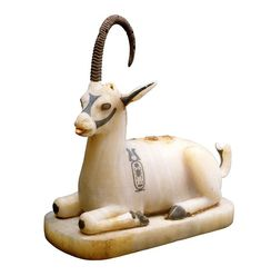 Ointment vase shaped ibex. Topped with natural horns, side bearing the cartouche of King Tutankhamen.
