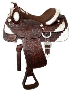 "16"" Fully tooled Double T Show Saddle with suede leather seat. Saddle features inskirt rigging and accented with tons of silver. Model: 407616 Seat: 16"" Suede Leather Bars: Semi Quarter horse Swell: 1"
