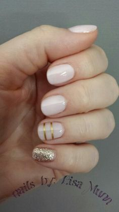Light pink and gold nails