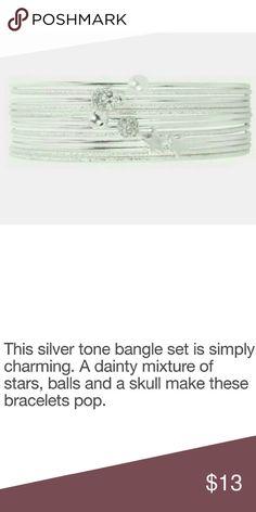 "JUST IN!▪Torrid Silver Bangle Set Set of 12 silvertone bracelets. 6 of the bracelets have either a star, ball, or skull on them. Bracelets measure approx. 3"" diameter. torrid Jewelry Bracelets"