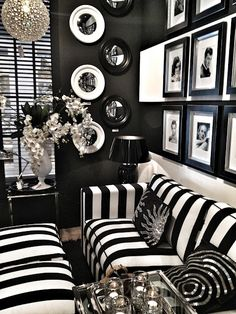 Superb black and white Living Room that loves its monochrome look so much that its everywhere! Its glamorous and elegant and shows how well harmonious hues work.