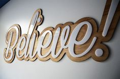 Finished believe sign. Birch wood base cut to shape on the cnc router with a white acrylic lettering overlay cut to shape on the laser machine.