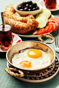 Traditional Turkish breakfast with fried eggs and tea. Eid Breakfast, Breakfast Soup, Turkish Breakfast, Breakfast Recipes, Turkish Food Traditional, Menemen Recipe, Cruffin Recipe, Easy Brunch Menu, Breakfast Presentation