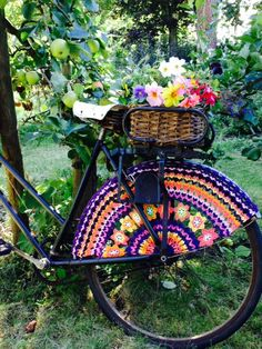 I need to make one for my bike.  Such a cool idea for scrap yarn!  Everyone Needs a Crochet Skirt Guard!