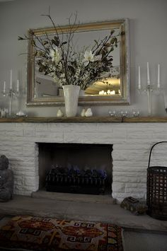 white painted brick, engineered stone hearth and mantle