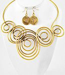 Gold coil neck and ear very cool! @ interior concepts