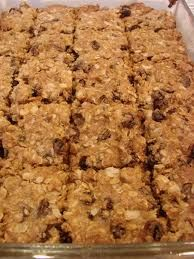 """Cinnamon Bun Protein Bars  1) Roast 2 C old fashioned oats in 350 degree oven.   2) Combine 1 C Almond Butter, 1/2 C Sugar-Free Syrup, Oats, 1/2 C Apple Sauce, 1 C Vanilla Protein Powder, 3/4 C Raisins, & 2 Tbsp Flax in a large bowl. 3) Spread out on a cookie pan or baking pan to about 1-2"""" thickness.  4) Bake about 20 min or until golden brown.  Cut and allow to cool. 5) Mix 3/4 C fat free cream cheese w/ 1 packet stevia and 1/2 Tbsp cinnamon.   When cool, spread cream cheese mixture over…"""