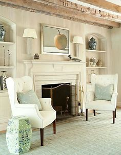 20 Great Fireplace Mantel Decorating Ideas | laurel home blog | wonderful living room with a gorgeous fireplace mantel | two pretty white wingchairs, soft green accents and rustic beams | designed by Leta Austin Foster
