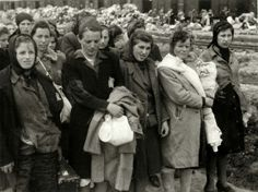 Birkenau, Poland, Women pronounced fit for labor standing on the platform after a selection, 05/1944.