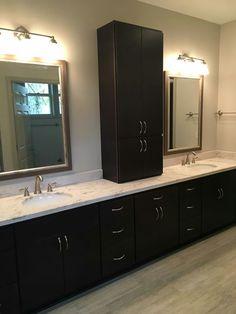 master bath is homecrest cabinets rainier door maple java stain the hardware is 53003