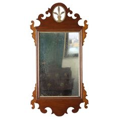 Mahogany Carved Chippendale Mirror with Gilt Urn | From a unique collection of antique and modern wall mirrors at http://www.1stdibs.com/furniture/mirrors/wall-mirrors/