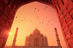 A view of Taj Mahal -- the symbol of love at sunrise! You might be resting in the cozy bed to capture Taj Mahal at sunrise, which is why we thought of giving you a glimpse of the same. 7 World Wonders, Le Taj Mahal, India Tour, Best Hotel Deals, Islamic Architecture, Building Architecture, Architecture Design, Agra, India Travel