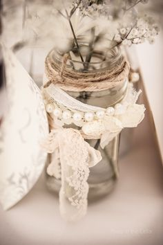 Jam-jar table decorations, vintage lace and pearls, photography Pixies in the Cellar