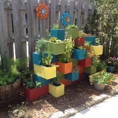 cinder block herb garden. :)..they look so much better painted rather than just gray..also would look great all painted one color that coordinates with house color..