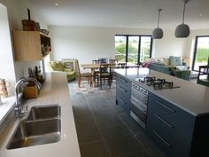 bespoke kitchen with composite stone worktops and grey spray painted doors