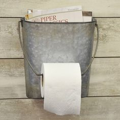 This is such a fun piece for the bathroom, we couldn't resist. We've never seen anything like this unusual toilet paper and magazine holder! It's so perfectly rustic, it's the finishing touch you've been looking for in your country primitive or farmhouse bathroom. Of course you can always repurpose this tp holder into a wall basket for flowers if needed. How many TP holders offer that?!?The oval shaped galvanized bucket features a wire handle that's easily removed and ... Country Farmhouse Decor, Primitive Kitchen, Entryway Decor, Toilet Paper, Kitchen Rustic, Toilet Paper Roll
