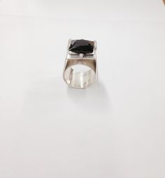 Freda's silver ring development to set a garnet from the 1 pierced sheet used for the whole ring