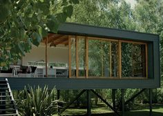 see through container home on stilts