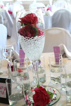 champagne glasses with flowers and floating candles...would love! centerpiece
