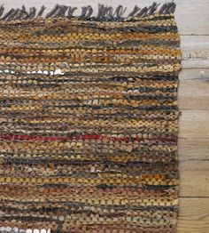 Scrap Leather Rug - beautiful leather remnants woven into a lovely textural rug. Now if I could figure out where to put it...