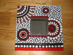 red, black and white mosaic mirror by regina french, via Flickr