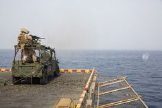 GULF OF ADEN (Sept. 9, 2013) Marines attached to the 26th MEU fire a .50 Caliber machine gun aboard the amphibious assault ship USS Kearsarge (LHD 3). Kearsarge is the flagship for the Kearsarge Amphibious Ready Group and, with the embarked 26th Marine Expeditionary Unit, is deployed in support of maritime security operations and theater security cooperation efforts in the U.S. 5th Fleet area of responsibility. (U.S. Navy photo by Mass Communication Specialist Seaman Travis DiPerna/Released)